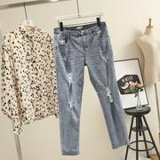 破洞水洗大码女装牛仔裤显瘦修腿200斤胖mm加肥加大小脚裤长裤