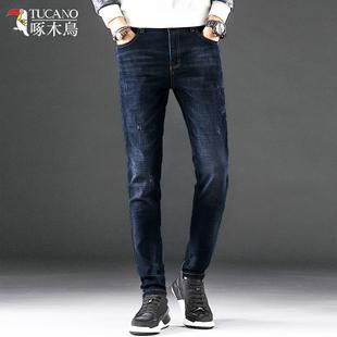 啄木鸟男士牛仔裤弹力青年裤子冬季长裤直筒宽松男裤